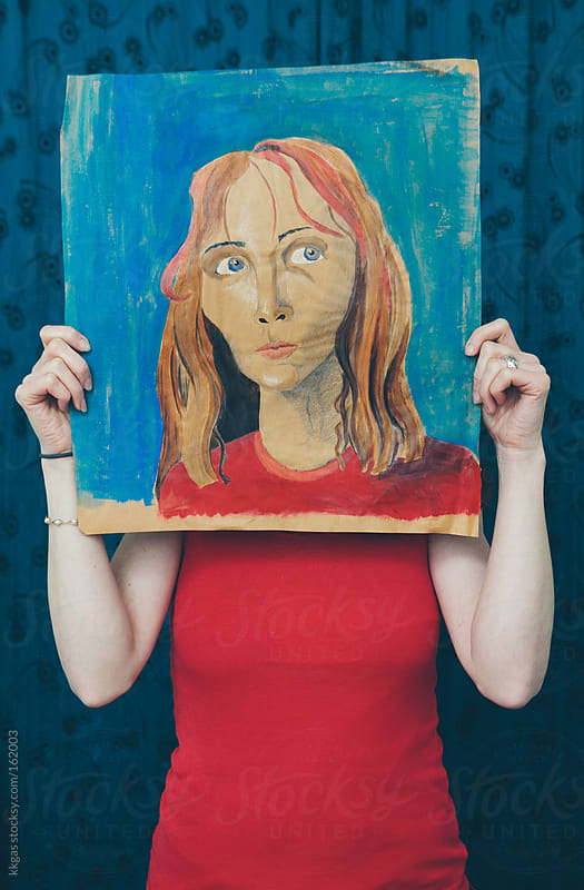 Woman holding a portrait of herself by kkgas for Stocksy United