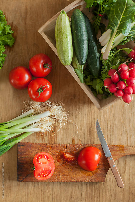 Cut Tomato and Fresh Veggies by Mosuno for Stocksy United