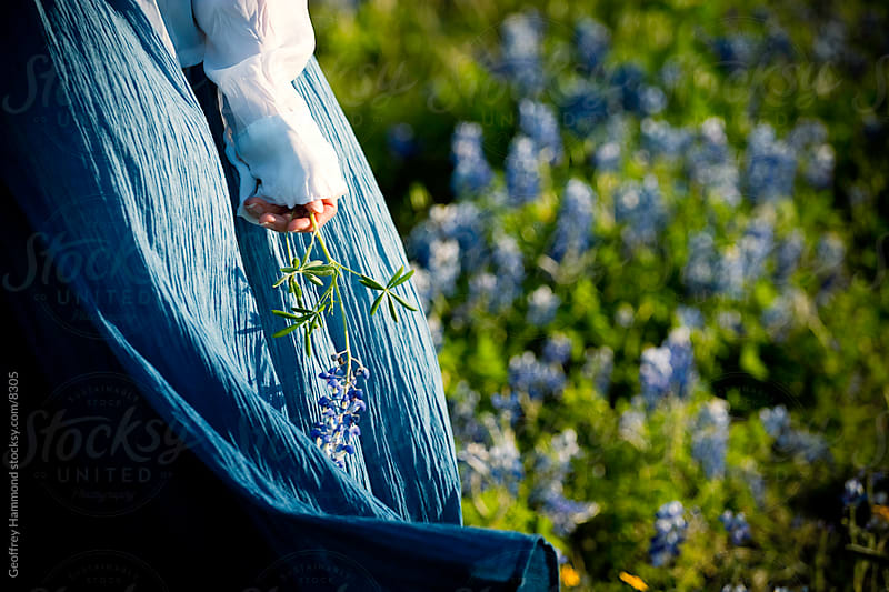 Woman in Bluebonnets by Geoffrey Hammond for Stocksy United