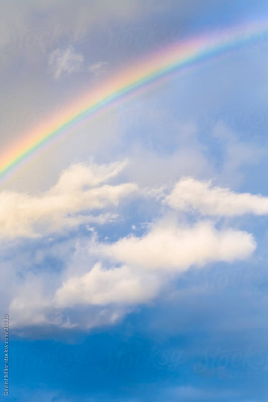 Bermuda, Atlantic Ocean, Rainbow and stormy skies by Gavin Hellier for Stocksy United