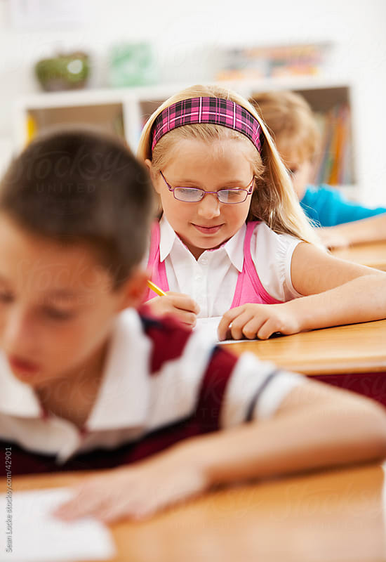 Classroom: Kids Taking Exam in Class by Sean Locke for Stocksy United