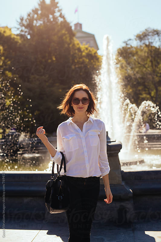 Smiling woman at the park by Good Vibrations Images for Stocksy United