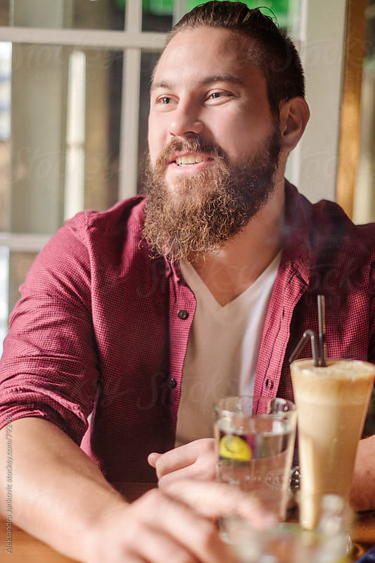 Handsome Bearded Man Sitting at the Cafe by Aleksandra Jankovic for Stocksy United
