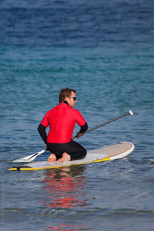 SUP - Stand Up Paddle Boarding on the Ocean by Rowena Naylor for Stocksy United