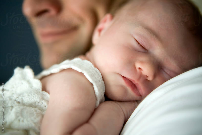 Father Holding Sleeping Baby Girl Over His Shoulder by Dina Giangregorio for Stocksy United