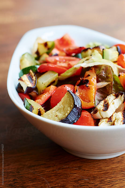 Salad with roasted summer vegetables by Harald Walker for Stocksy United