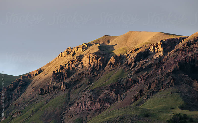 Remote rocky mountain landscape at sunset by Matthew Spaulding for Stocksy United