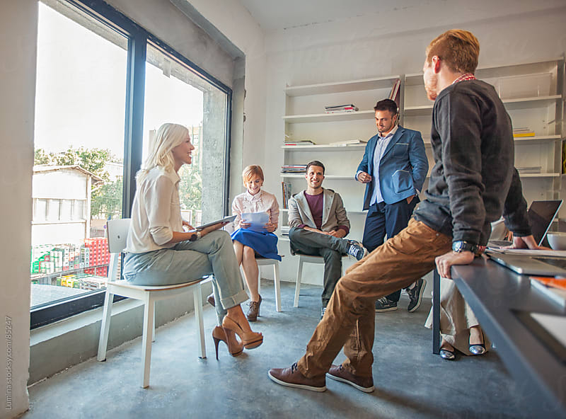 Business Team Chatting at Their Office by Lumina for Stocksy United