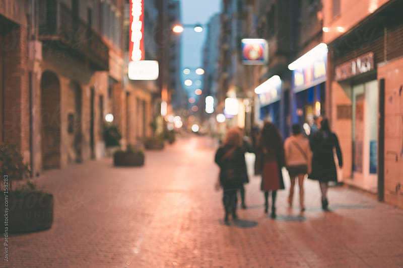group of people walking down the shopping street by Javier Pardina for Stocksy United