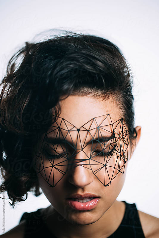 GEOMETRIC MASK GIRL by Rob Martinez for Stocksy United