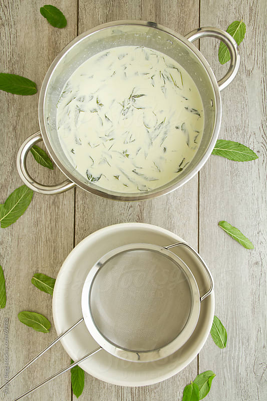 Infusing mint leaves in milk and cream by Kirsty Begg for Stocksy United
