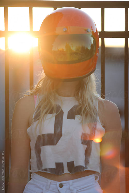 A Woman Wearing A Motorcycle Helmet by Carey Haider for Stocksy United