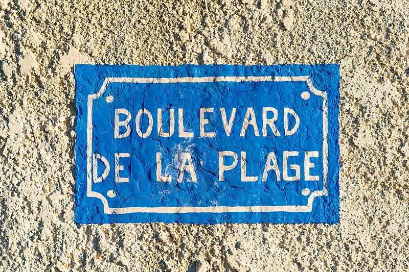 Boulevard de la Plage painted on a wall by Juri Pozzi for Stocksy United