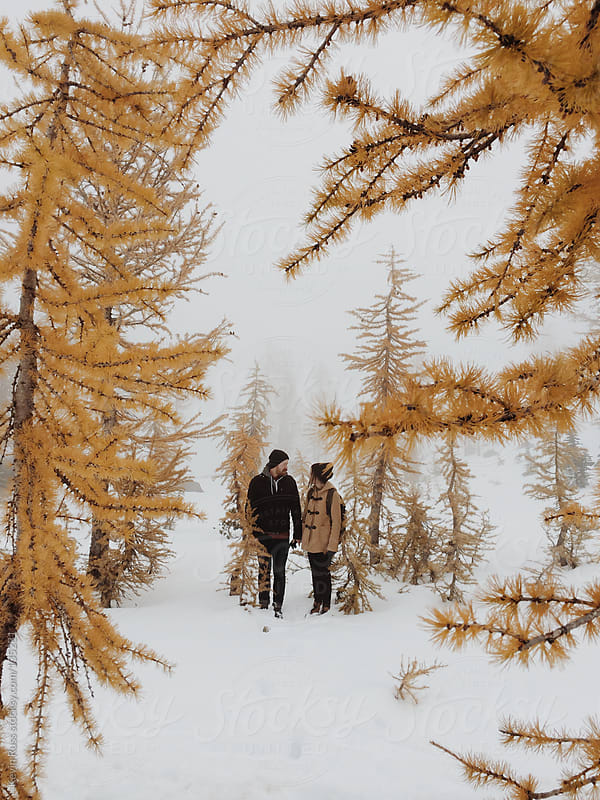 Couple in the Snow by Kevin Russ for Stocksy United