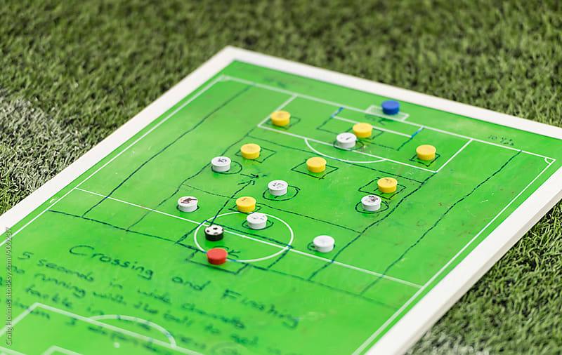 Strategic sports boards preparing for a soccer match. by Craig Holmes for Stocksy United