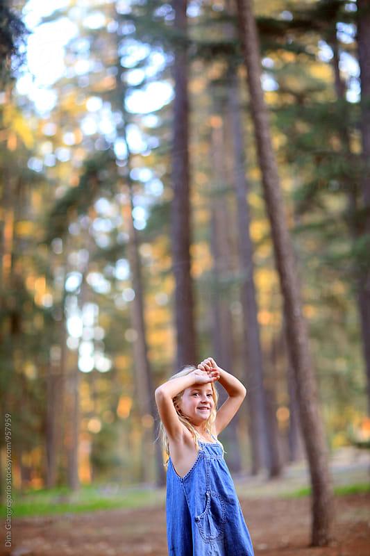 Blonde Girl in Forrest In Denim Dress by Dina Giangregorio for Stocksy United