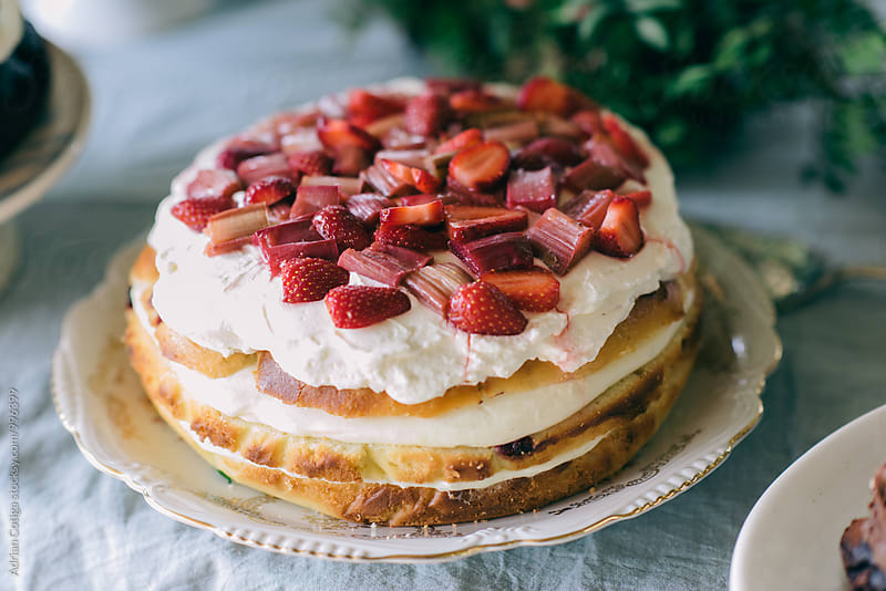 Cake with rhubarb and strawberries by Adrian Cotiga for Stocksy United