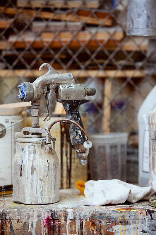 Woodworking: Messy Old Paint Sprayer On Workbench by Sean Locke for Stocksy United