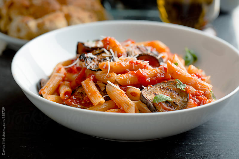 Pasta with eggplant and tomato. by Davide Illini for Stocksy United