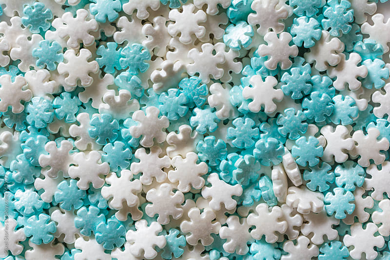 White and blue snowflake sprinkles  by Pixel Stories for Stocksy United