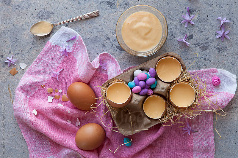 Easter dessert - custard served in eggshells by Nadine Greeff for Stocksy United