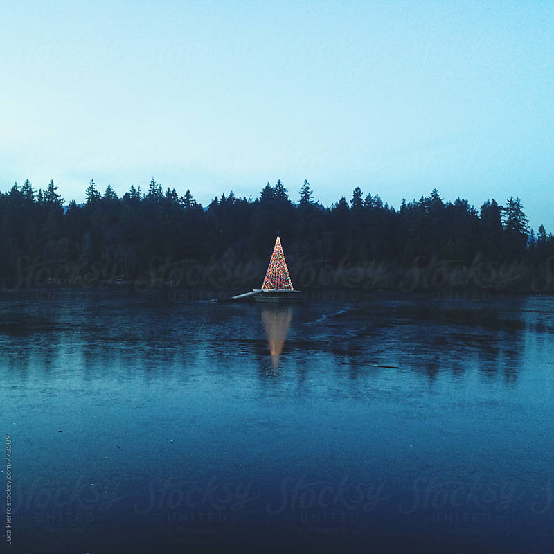 Christmas tree on a frozen lake, Vancouver by Luca Pierro for Stocksy United