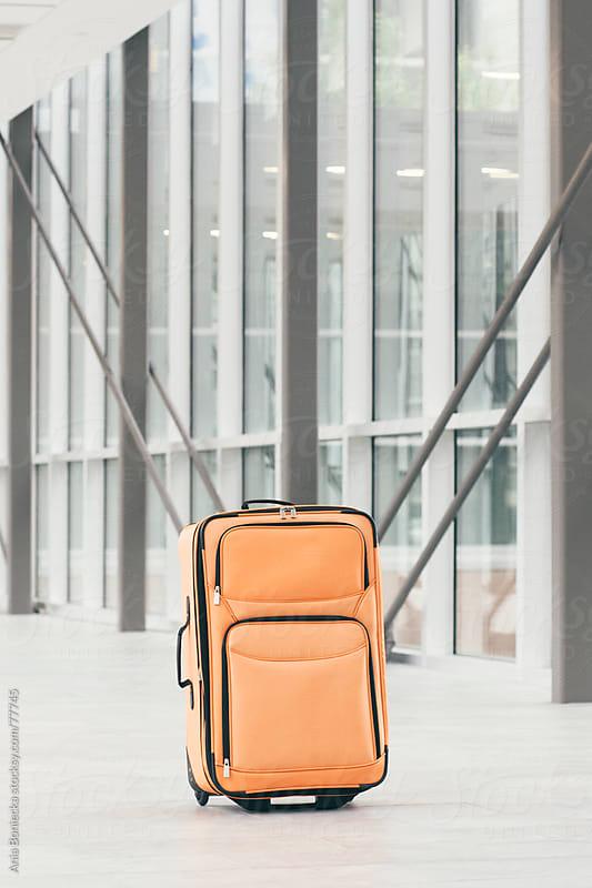 Lugage sitting in an empty hall by Ania Boniecka for Stocksy United