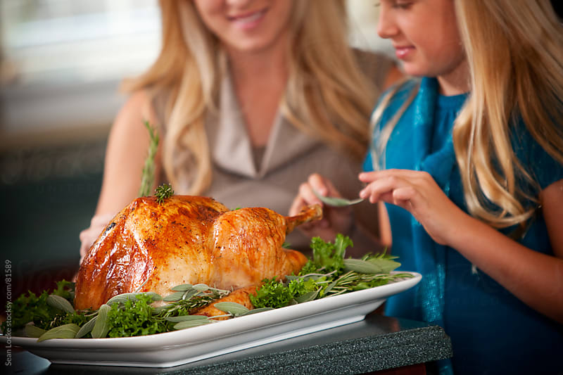Thanksgiving: Surrounding the Turkey with Herbs by Sean Locke for Stocksy United