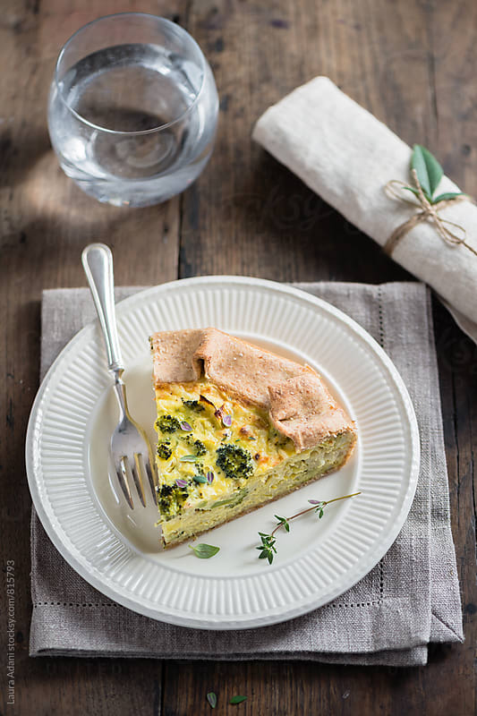 Slice of savory rice and broccoli tart by Laura Adani for Stocksy United