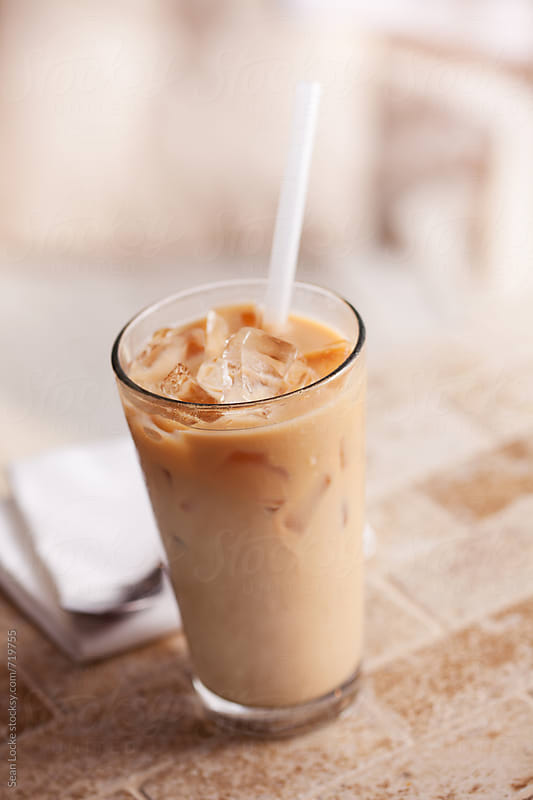 Iced Chai Tea Drink With Straw by Sean Locke for Stocksy United