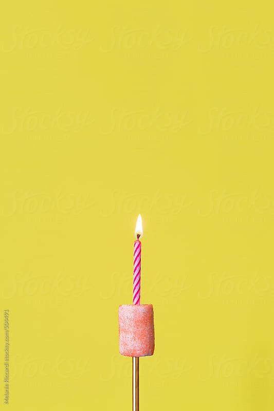 Birthday candle in a glittery marshmallow by Melanie Riccardi for Stocksy United