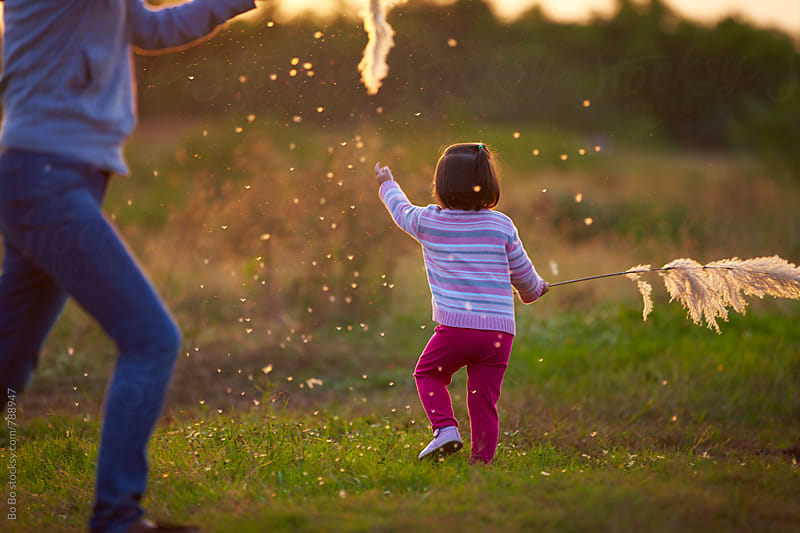 happy little asian girl playing with her mother outdoor in the autumn rural by Bo Bo for Stocksy United