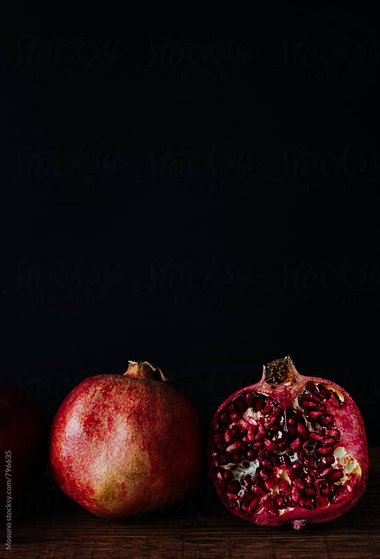 Pomegranate Against Dark Background by Mosuno for Stocksy United