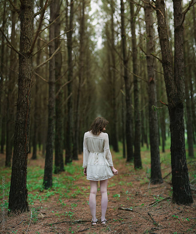 Girl in pine forest in white dress by Christian Gideon for Stocksy United