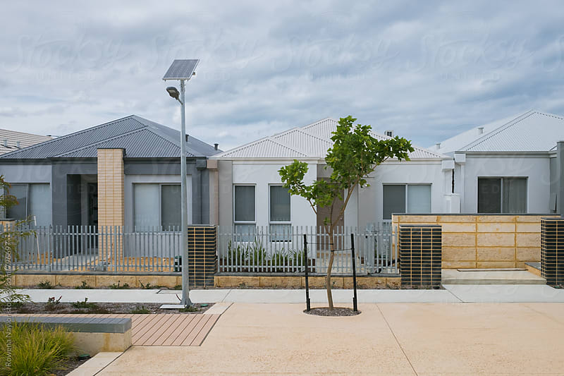 New housing in brand new suburbs creating urban sprawl by Rowena Naylor for Stocksy United