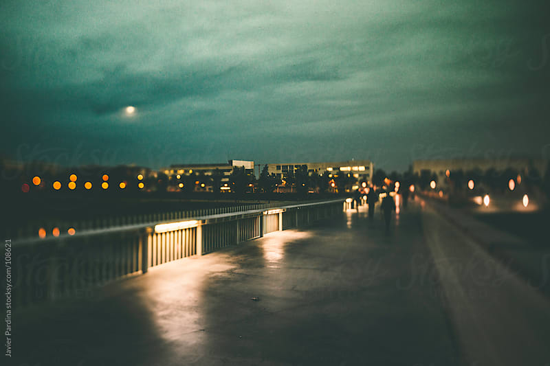 the moon on the sky at nigh, from the bridge by Javier Pardina for Stocksy United