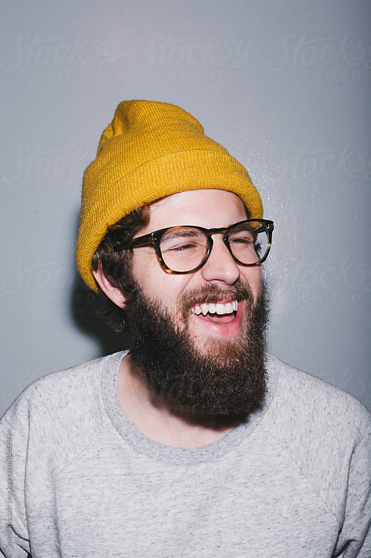 A Young Man with A Beard and Beanie by Caleb Thal for Stocksy United