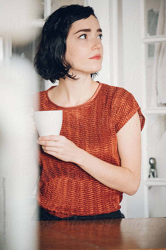 Beautiful woman having a coffee indoors by Good Vibrations Images for Stocksy United