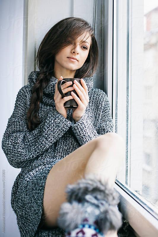 Beautiful young woman drinking coffee by Aleksandar Novoselski for Stocksy United
