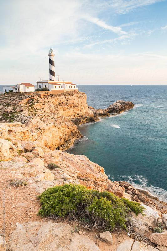 Lighthouse and house on de Mediterranean Coast by Marilar Irastorza for Stocksy United