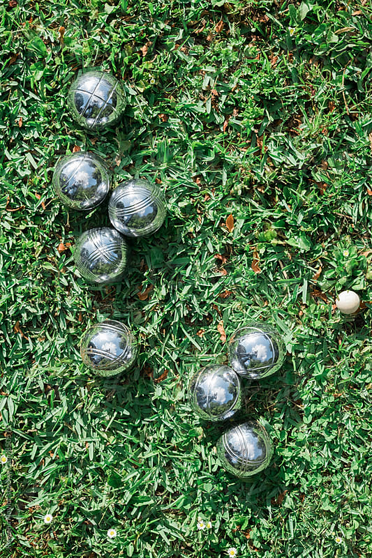 Patonk boules on a lawn by Rowena Naylor for Stocksy United