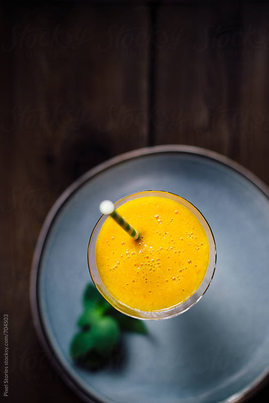 Peach smoothie by Pixel Stories for Stocksy United