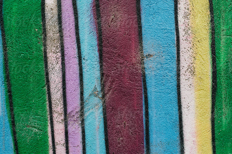 Colorful stripes painted on a wall by Gabriel (Gabi) Bucataru for Stocksy United