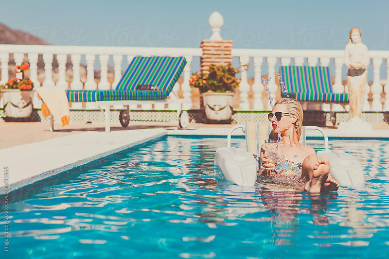 Beautiful blond woman in Pool by Image Supply Co for Stocksy United