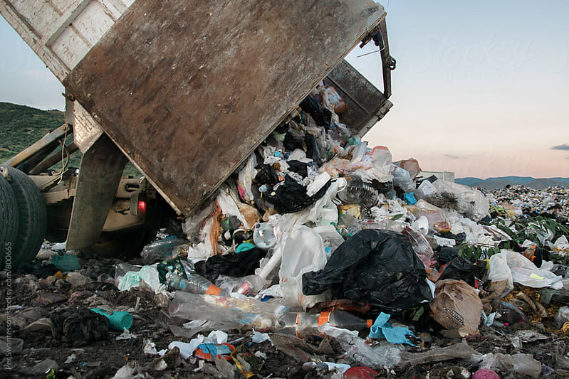 Garbage truck at landfill by Per Swantesson for Stocksy United
