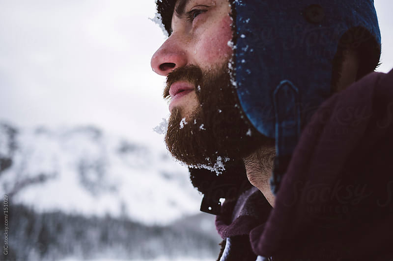 Man with beard in the winter by GIC for Stocksy United