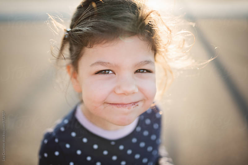 Smiling girl with a messy face by Lea Csontos for Stocksy United