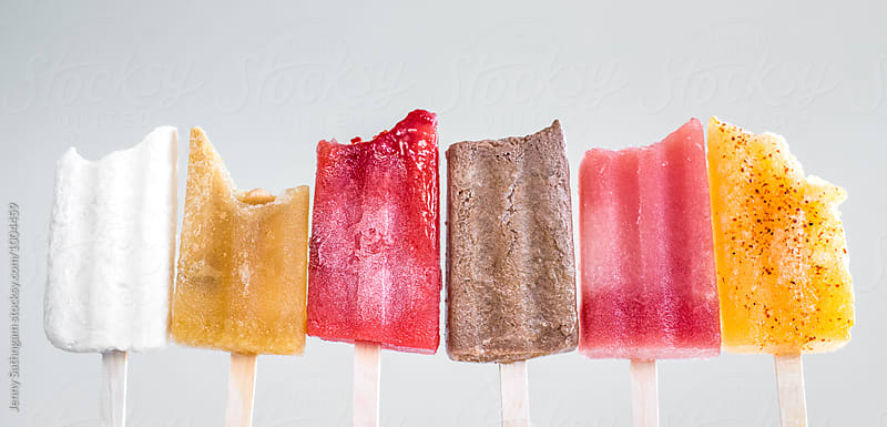 Half Eaten Row of Colorful Popsicles by Jenny Sathngam for Stocksy United