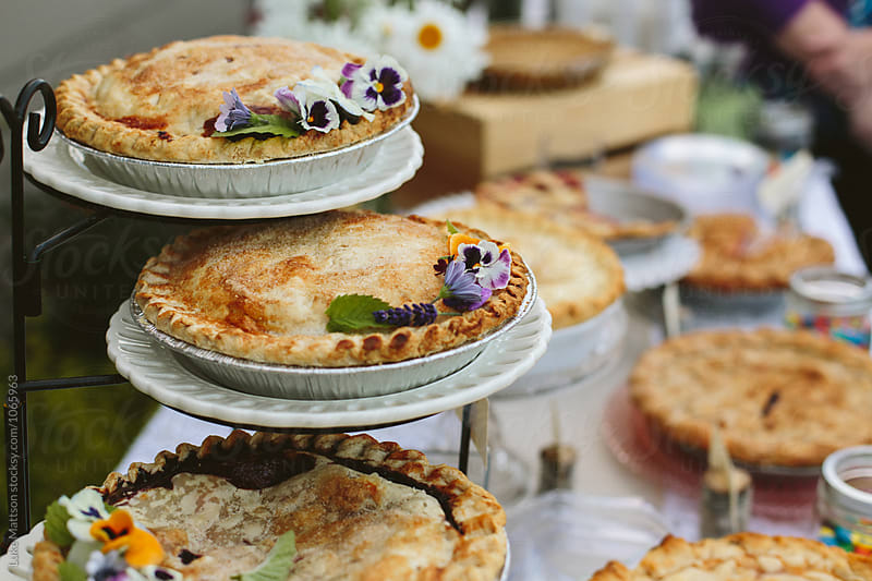 Assorted Home Baked Pies Displayed On Dessert Table by Luke Mattson for Stocksy United