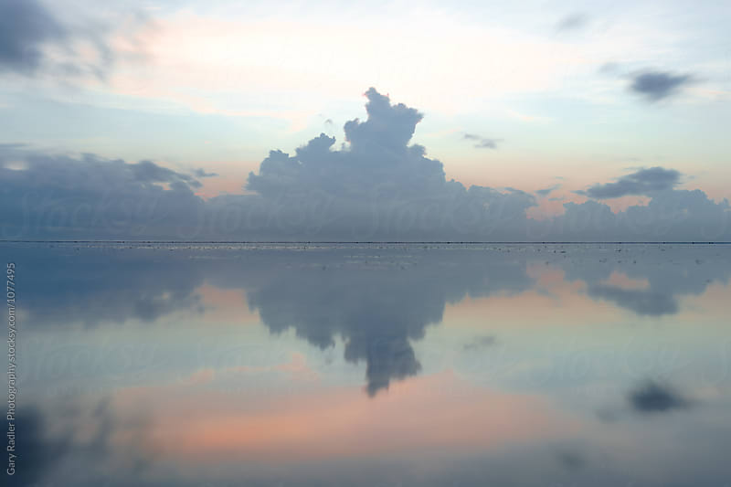 Cumulus Cloud Reflected in the Sea by Gary Radler Photography for Stocksy United